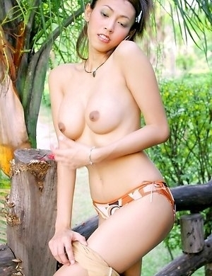 You will not want to miss Chan Ching Ming as she unbuttons her top. She looks down at her tits and her hands rub over her tits.