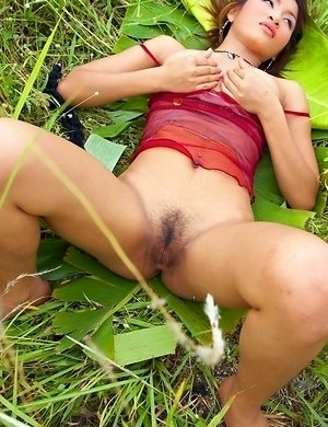 Take a look at this amazing photo session and enjoy watching sexy Sonya Pawalin as she walks around the meadow.